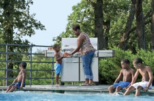 Weber Summit S-670 Children in Pool , Barbecue at Poolside with Mom serving food to children Pollocks Home Hardware