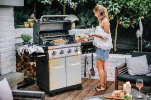 Broil King Regal S 420 Pro Lifestyle image of women cooking at a barbecue