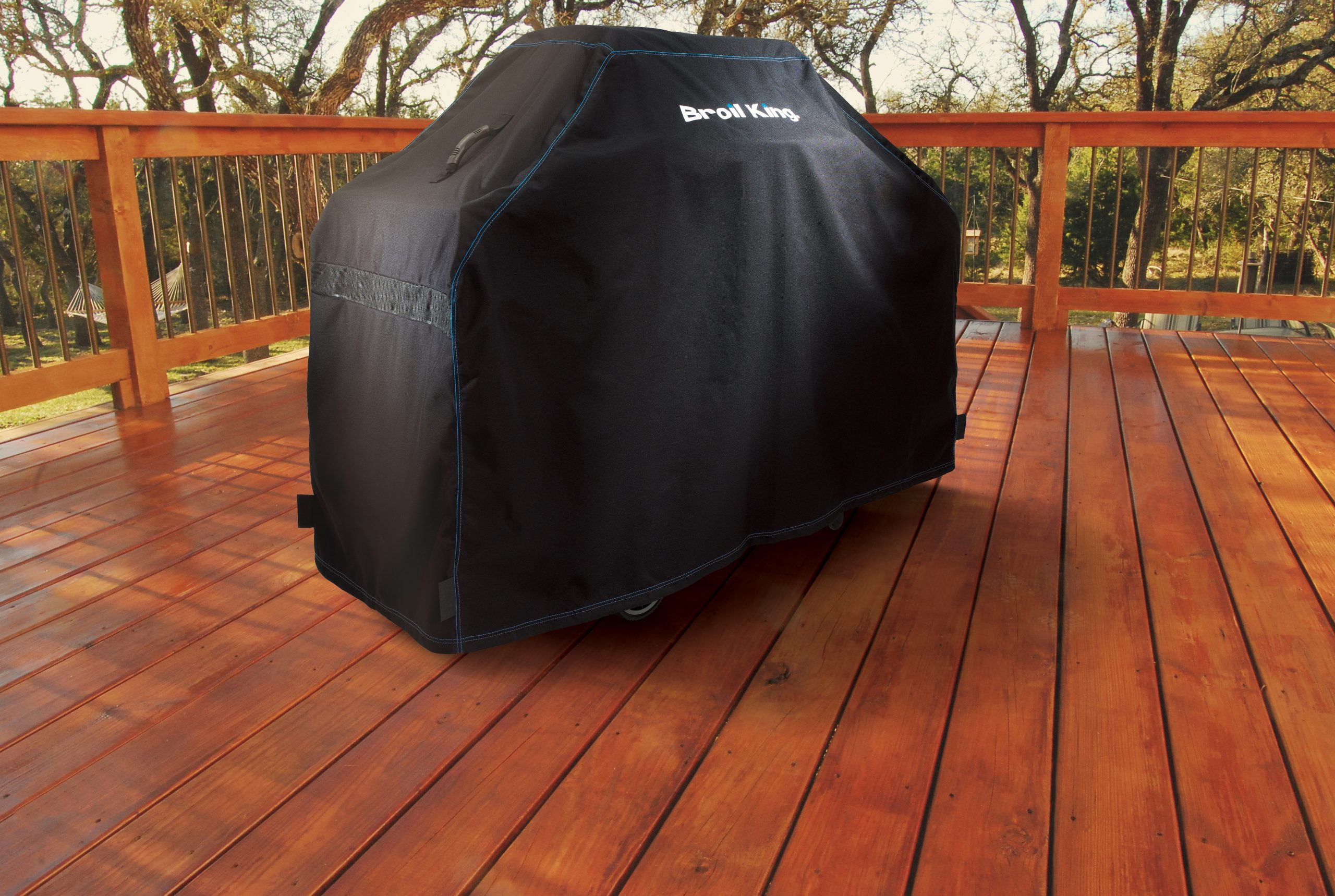 Broil King Grill Cover 68492 sitting on a wood patio